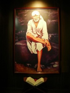 Sai Baba sitting on Stone picture