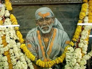 Sai Baba picture above stone Dwarkamai
